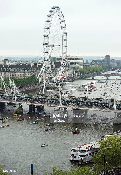 Paddle boats pass under Blackfriars Bridge as they participate in the Thames Diamond Jubilee River Pageant on June 3 2012 in London England For only...