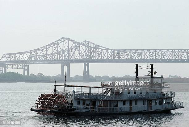 Paddle steamer on the Mississippi river with the GNO Bridge in the background New Orleans Louisiana United States of America