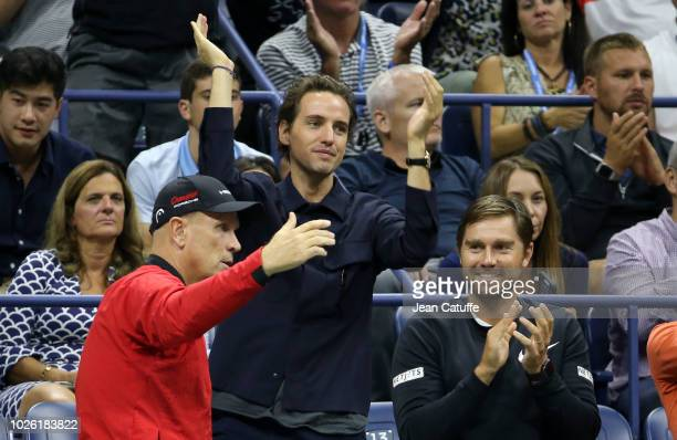Paddle8 cofounder Alexander Gilkes celebrates the victory of his girlfriend Maria Sharapova of Russia along with her coach Thomas Hogstedt during day...