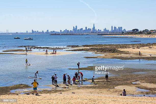Paddleboard lessons and Melbourne cityscape