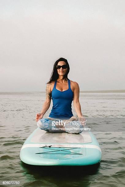 Paddleboard Yoga Seated Pose