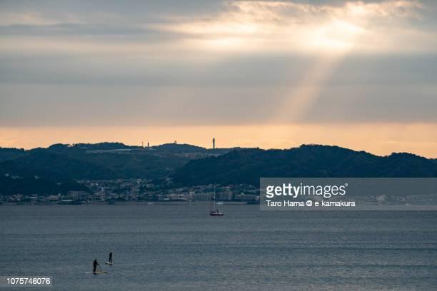 Paddleboarders and morning sunbeam on Kamakura and Yokosuka cities and Hayama town and Sagami Bay in Kanagawa prefecture in Japan