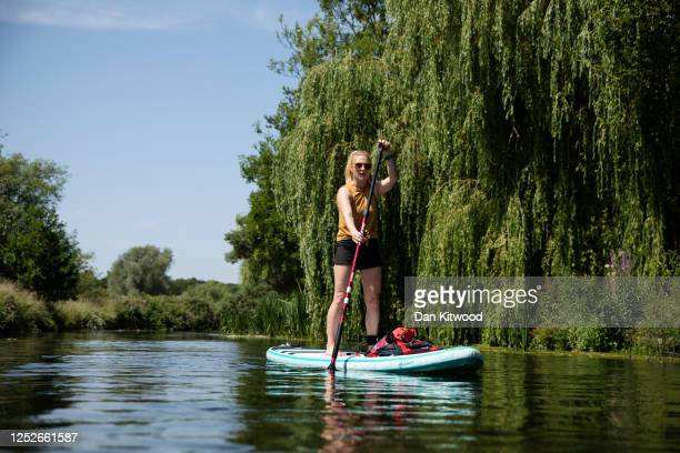 Paddleboarders meander down the Great Stour on June 26, 2020 in Fordwich, United Kingdom. The UK is experiencing a summer heatwave, with temperatures...