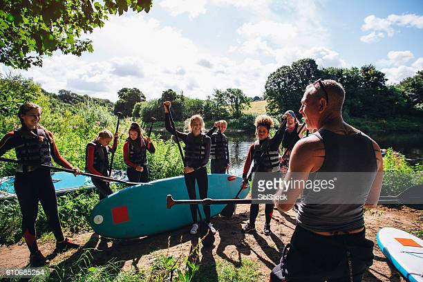 paddleboarding class - water sport stock photos and pictures