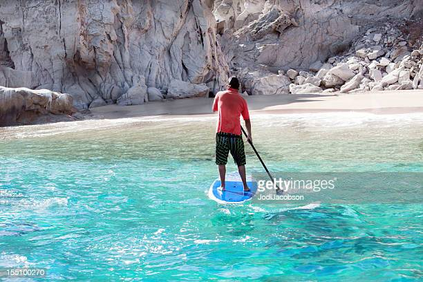Paddleboarding in turquoise waters