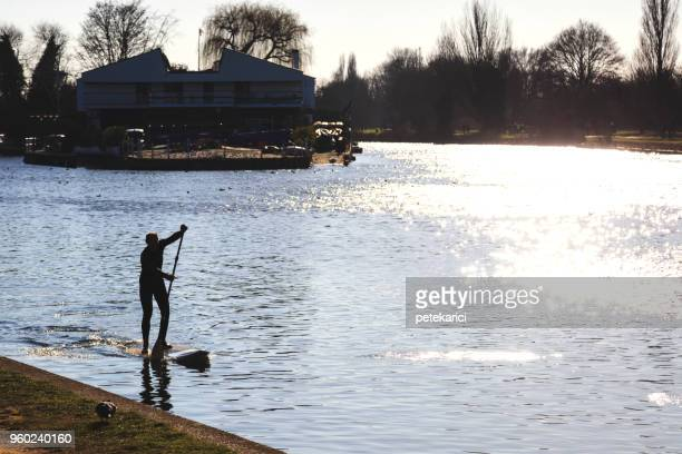 Paddleboarding on River Thames in Kingston upon Thames, UK