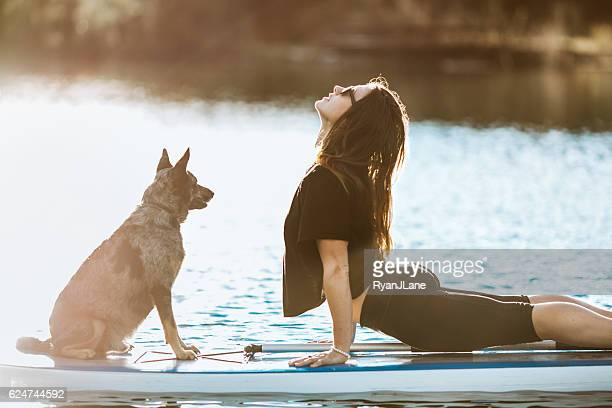 paddleboarding woman with dog - paddleboard stock pictures, royalty-free photos & images