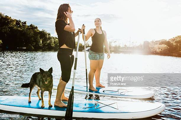 Paddleboarding Women With Dog
