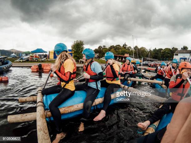 paddling a raft - a team stock photos and pictures