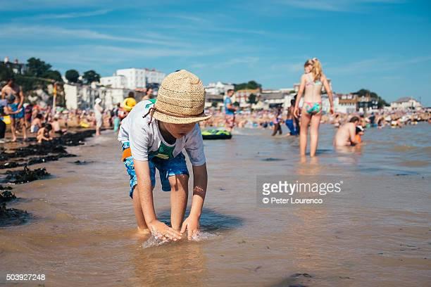 paddling in the sea - peter lourenco stockfoto's en -beelden