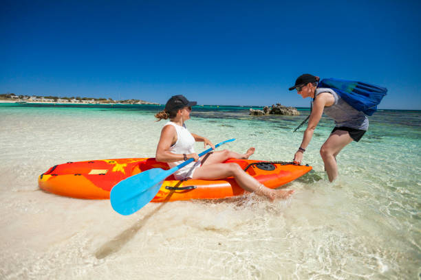 Paddling instructor teaching student, Perth, Western Australia, Australia