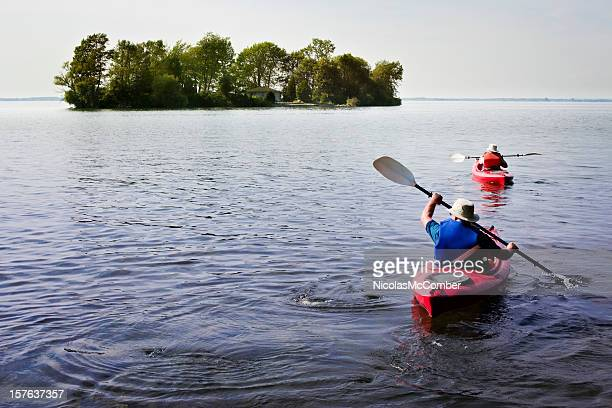 paddling on a lake - river st lawrence stock pictures, royalty-free photos & images