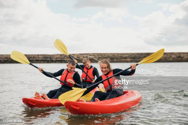 paddling out in the sea - sea kayaking stock pictures, royalty-free photos & images