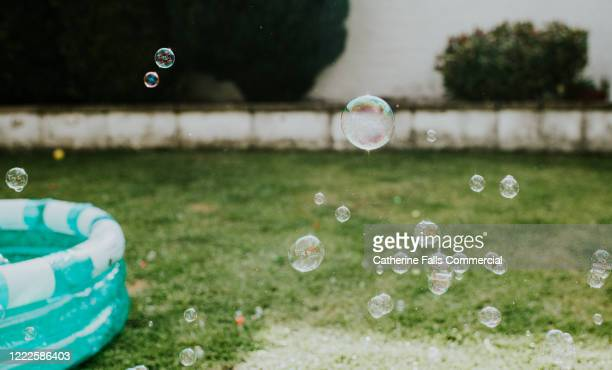 paddling pool and bubbles - inflating stock pictures, royalty-free photos & images