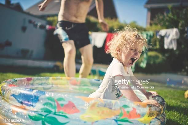 paddling pool fun - värmebölja bildbanksfoton och bilder