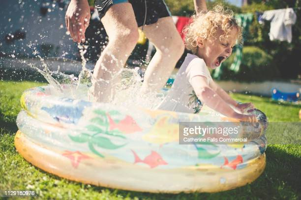 paddling pool fun - heatwave stock pictures, royalty-free photos & images