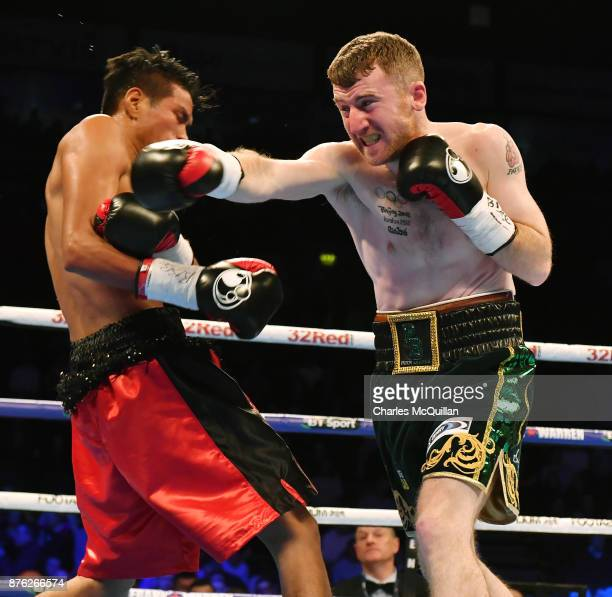 Paddy Barnes and Eliecer Quezada during their WBO Intercontinental Flyweight Championship bout on the Frampton Reborn boxing bill at SSE Arena...