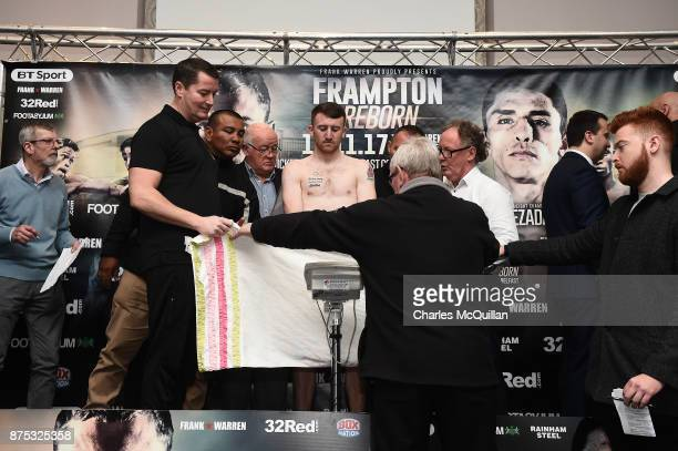 Paddy Barnes watches the scales from behind a towel during his weigh in on the Frampton v Garcia boxing bill at the Clayton Hotel on November 17 2017...