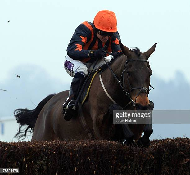 Paddy Brennan and Fundamentalist clear the last fence to land The 123sportcom Graduation Steeple Chase Race run at Ascot Racecourse on December 22 in...