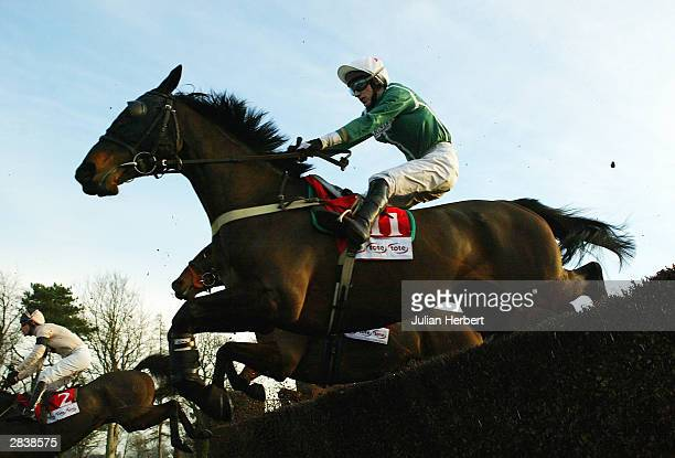 Paddy Brennan and Igloo D'Estruval clear an early fence before landing The Southern National Race run at Fontwell Park on December 31 2003 at...