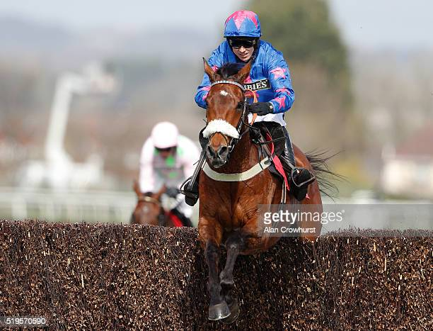 Paddy Brennan riding Cue Card clear the last to win The Betfred Bowl Steeple Chase at Aintree Racecourse on April 7 2016 in Liverpool England