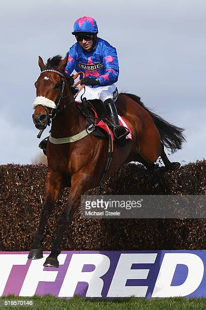 Paddy Brennan riding Cue Card clears the last on his way to victory in the Betfred Bowl steeplechase at Aintree Racecourse on April 7 2016 in...