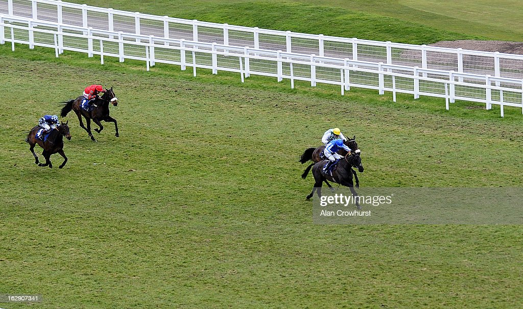 Paddy Brennan riding Silver Roque (R) win The Berry Bros & Rudd Handicap Steeple Chase at Newbury racecourse on March 01, 2013 in Newbury, England.