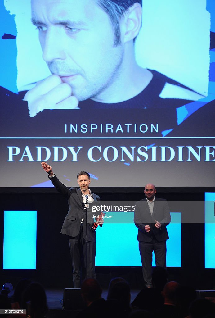 Paddy Considine accepts the Empire Inspiration award, presented by Shane Meadows (R) on stage during the Jameson Empire Awards 2016 at The Grosvenor House Hotel on March 20, 2016 in London, England.
