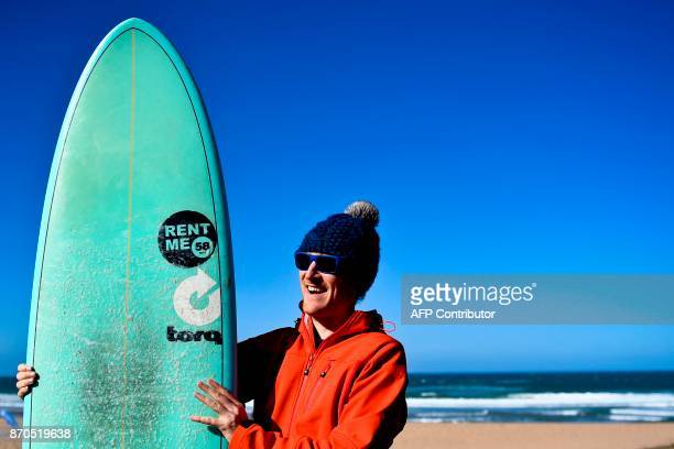 Paddy Cosgrave Irish entrepreneur and cofounder of Web Summit poses with a surfboard at Foz do Lizandro beach in Ericeira on November 5 2017 during a...
