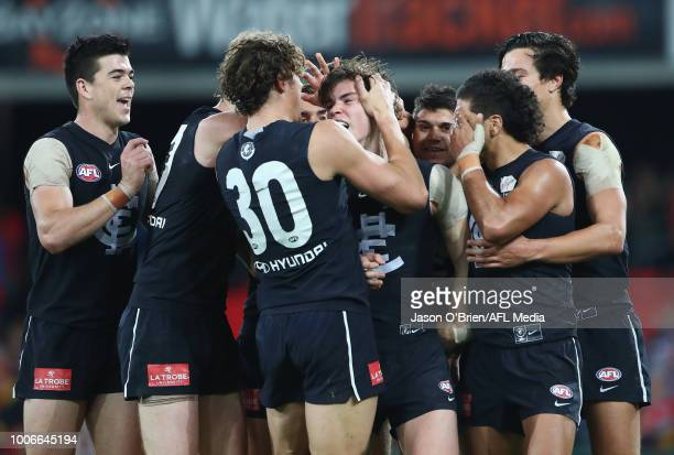 Paddy Dow of the blues celebrates a goal during the round 19 AFL match between the Gold Coast Suns and the Carlton Blues at Metricon Stadium on July...