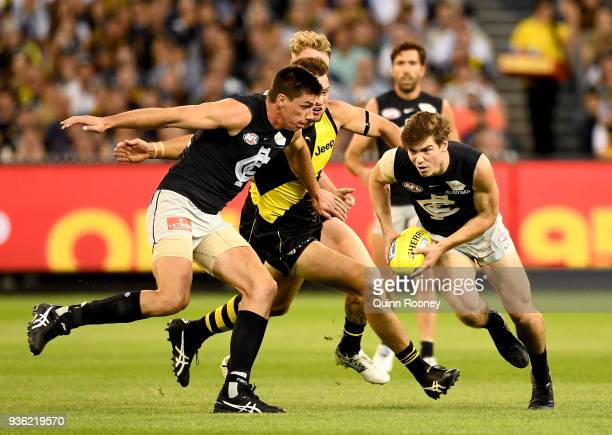 Paddy Dow of the Blues gathers the ball during the round one AFL match between the Richmond Tigers and the Carlton Blues at Melbourne Cricket Ground...