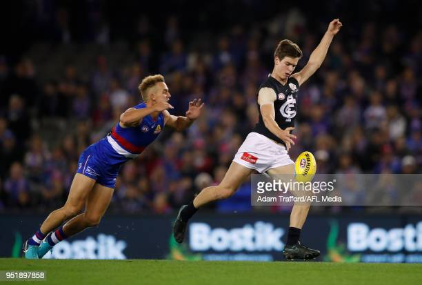 Paddy Dow of the Blues in action ahead of Mitch Wallis of the Bulldogs during the 2018 AFL round six match between the Western Bulldogs and the...