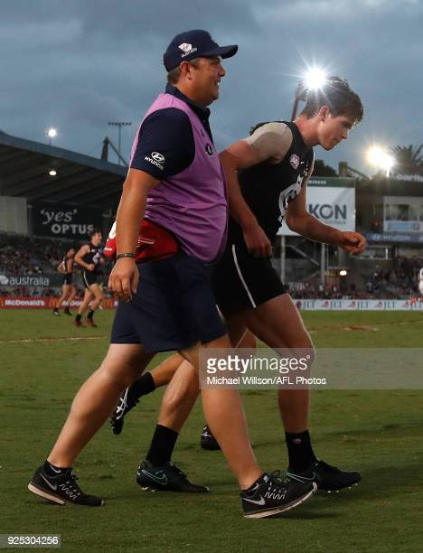 Paddy Dow of the Blues is helped from the field during the AFL 2018 JLT Community Series match between the Carlton Blues and the St Kilda Saints at...