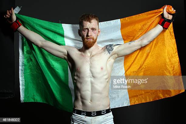 Paddy Holohan of Ireland poses for a post fight portrait backstage during the UFC Fight Night event at the TD Garden on January 18 2015 in Boston...