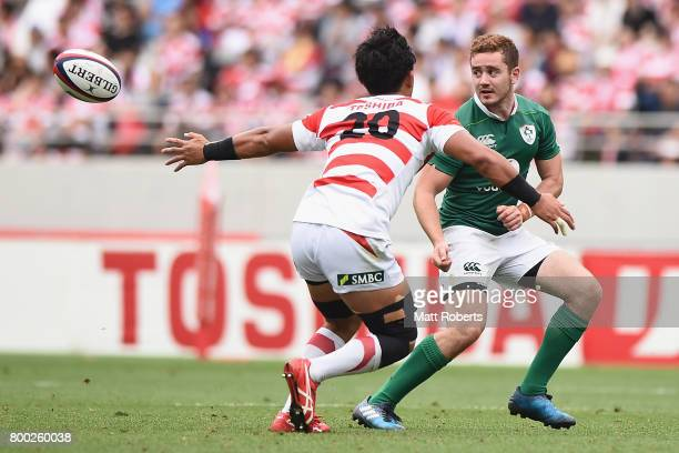 Paddy Jackson of Ireland passes the ball under pressure during the international rugby friendly match between Japan and Ireland at Ajinomoto Stadium...