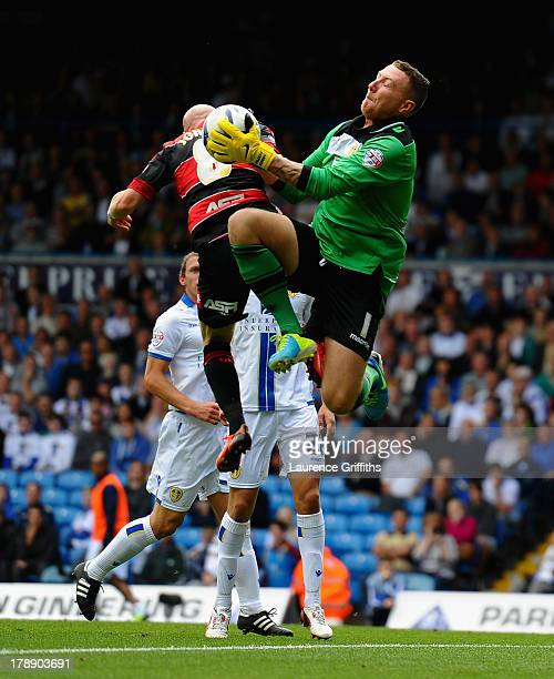 Paddy Kenny of Leeds United battles with Andrew Johnson of Queens Park Rangers during the Sky Bet Championship match between Leeds United and Queens...