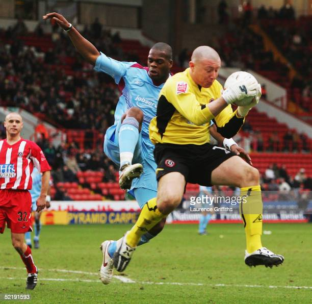 Paddy Kenny of Sheffield United claims the ball from Marlon Harewood of West Ham during the FA Cup Fourth Round Replay match between Sheffield United...
