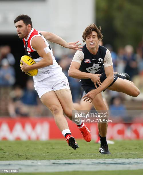 Paddy McCartin of the Saints and Caleb Marchbank of the Blues in action during the AFL 2018 JLT Community Series match between the Carlton Blues and...