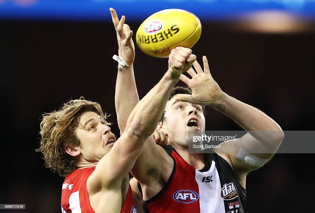 Paddy McCartin of the Saints and Dane Rampe of the Swans compete for the ball during the round 21 AFL match between the St Kilda Saints and the Sydney Swans at Etihad Stadium on August 13, 2016 in Melbourne, Australia.