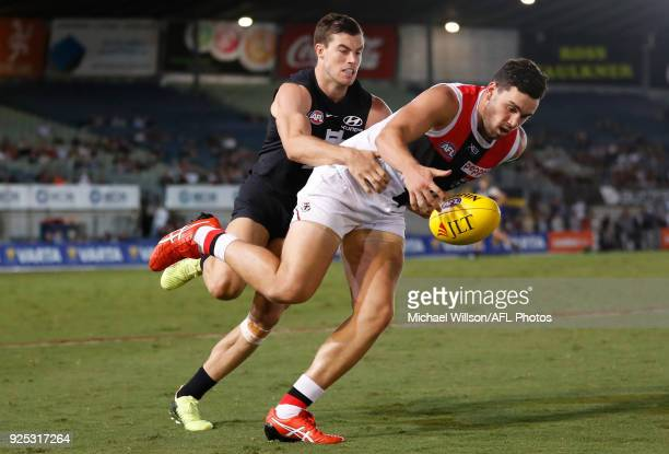 Paddy McCartin of the Saints and Lachie Plowman of the Blues compete for the ball during the AFL 2018 JLT Community Series match between the Carlton...