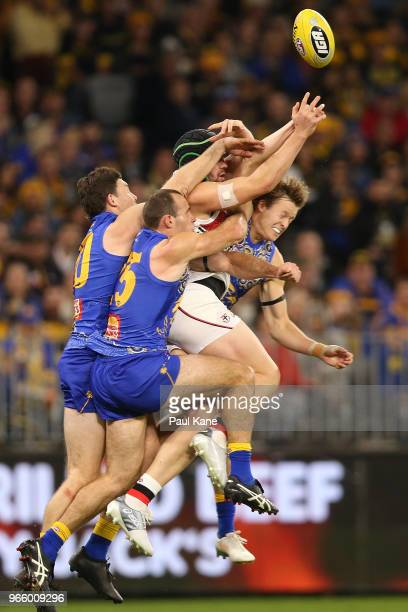 Paddy McCartin of the Saints contests the ball against Jeremy McGovern Shannon Hurn and Jackson Nelson of the Eagles during the round 11 AFL match...