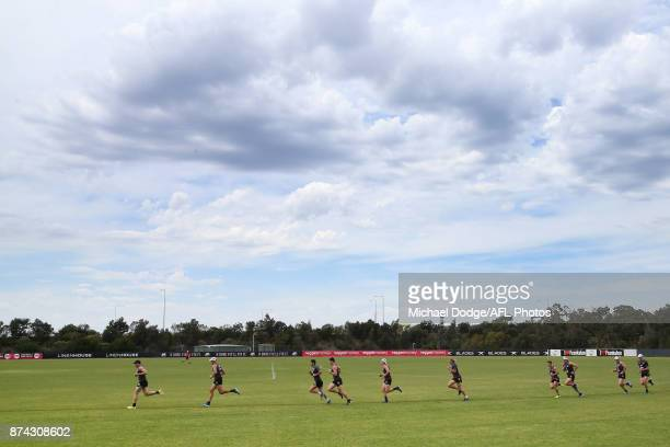 Paddy McCartin of the Saints leads teammates in a sprint around the oval during a St Kilda Saints AFL training session at Linen House Oval on...