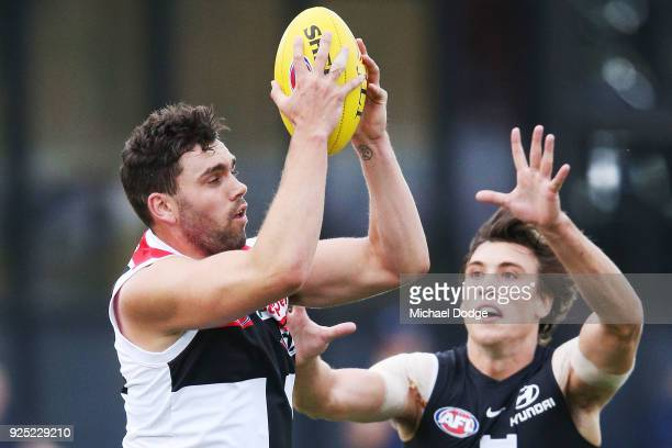 Paddy McCartin of the Saints marks the ball against Caleb Marchbank of the Blues during the JLT Community Series AFL match between the Carlton Blues...