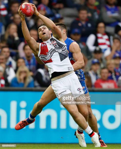 Paddy McCartin of the Saints marks the ball ahead of Marcus Adams of the Bulldogs during the 2017 AFL round 10 match between the Western Bulldogs and...