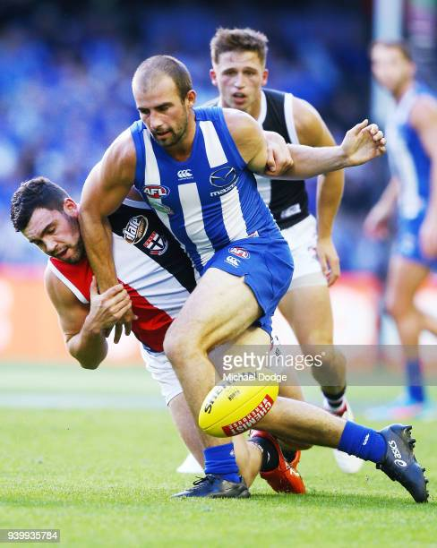 Paddy McCartin of the Saints tackles Ben Cunnington of the Kangaroos during the round two AFL match between the North Melbourne Kangaroos and the St...