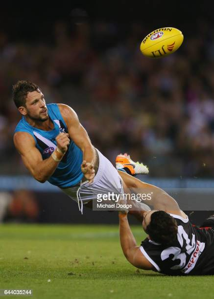 Paddy McCartin of the Saints tackles Travis Boak of the Power who handballs during the JLT Community Series AFL match between the St Kilda Saints and...