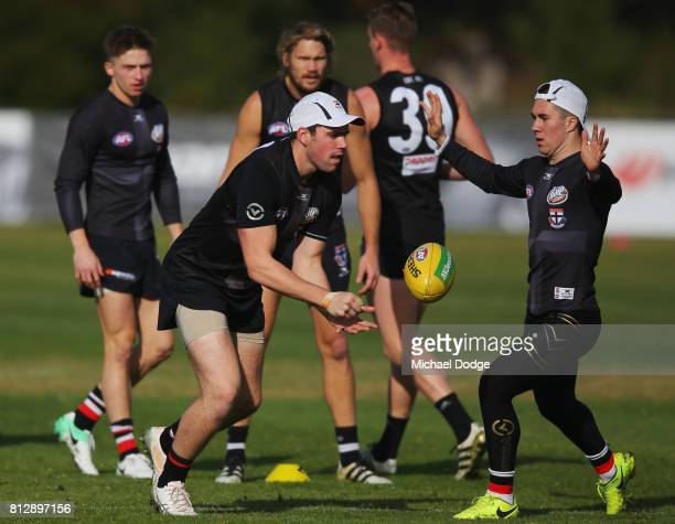Paddy McCartin out from concussion handballs past Jade Gresham during a St Kilda Saints AFL training session at Linen House Oval on July 12 2017 in...