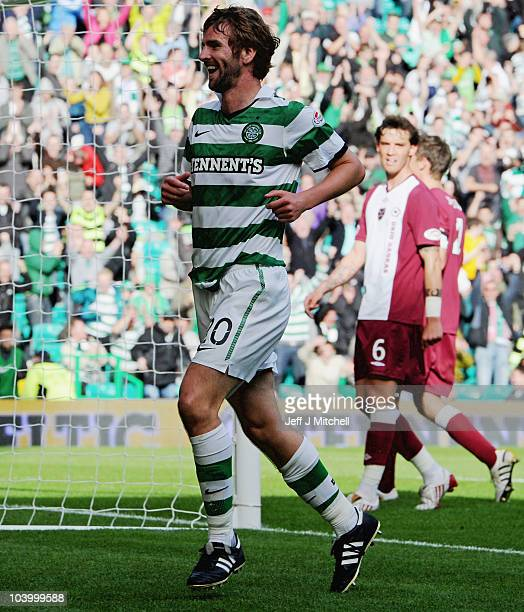 Paddy McCourt of Celtic celebrates after scoring during the Clydesdale Bank Premier League match between Celtic and Hearts at Celtic Park on...