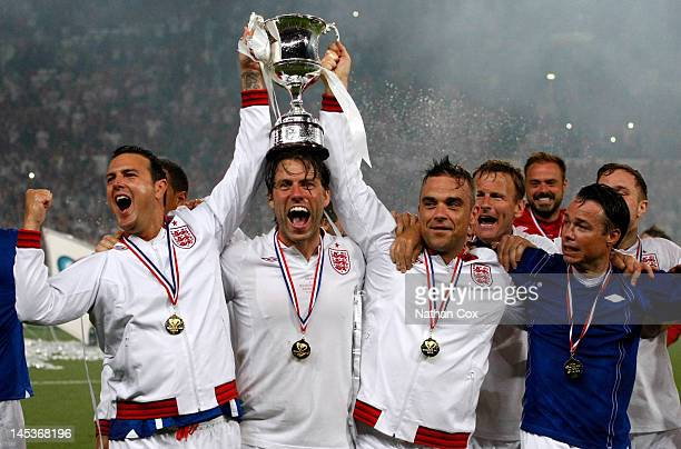 Paddy McGuiness John Bishop Robbie Williams and Graeme La Saux participate in the Soccer Aid football match in aid of Unicef at Old Trafford at Old...