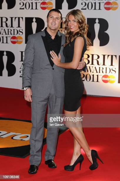 Paddy Mcguinness and Christine Martin arrive on the red carpet for The BRIT Awards 2011 at the O2 Arena on February 15 2011 in London England